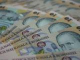 Salariul mediu net a scazut cu 1,1% in februarie, la 1.411 lei