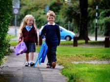 Amenzi pentru parintii care nu isi duc copiii la timp la scoala