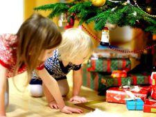 De ce trebuie sa le cumperi copiilor trei cadouri de Craciun. Nici mai mult nici mai putin